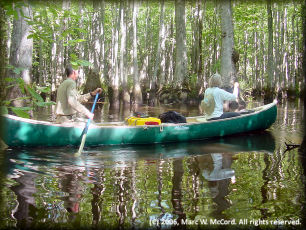 Larry Rice and Mara Kahn canoeing Bayou deView