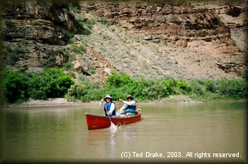 A canoes carries paddlers down the Green River