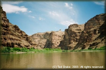 The Green River flows in stark contrast to the surrounding desert