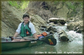 Jill Britt exploring a creek that feeds the Kiamichi River
