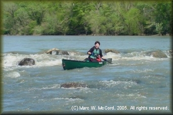 Jill Britt running a ledge drop on the Kiamichi at 3,200 cfs