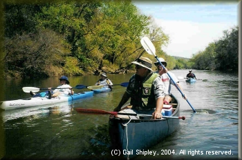 Carolee Doty takes the laid back approach as Roy Pipkin and Brian Jackson paddle by