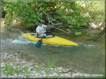 Bryant Hall kayaking a small rapid on the Nueces River
